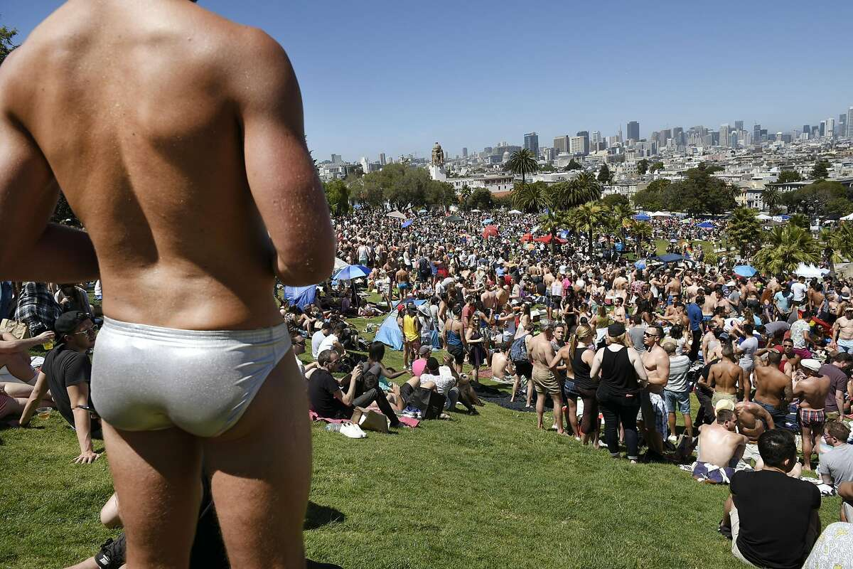 Michael Quidort of San Diego, left, looks out over the crowd during the San Francisco Dyke March rally at Dolores Park in San Francisco, CA Saturday, June 25, 2016.