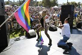 Nicole Lopez, left, and Kaydance DeMere dance on stage during the San Francisco Dyke March rally at Dolores Park in San Francisco, CA Saturday, June 25, 2016.