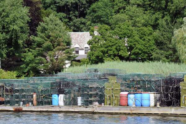 Lobster pots sit idle on a floating dock in the Mianus River near the Morano Bridge in Greenwich in 2014. Due to a dramatic fall-off of the lobster catch in and around Long Island Sound since the late '90s, the number of full-time lobstermen has dramatically decreased.