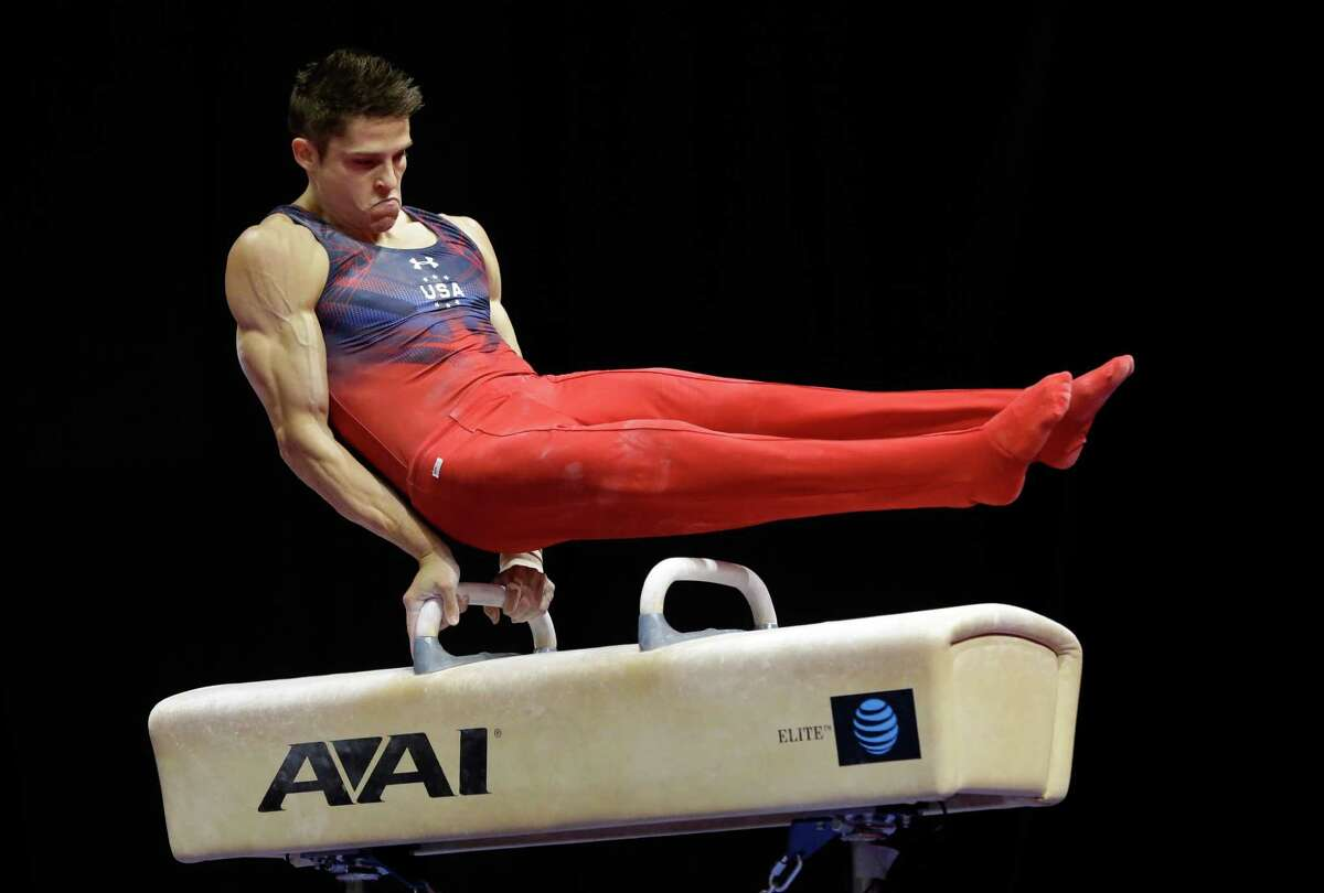 Chris Brooks competes on the pommel horse during the U.S. men's Olympic gymnastics trials Saturday, June 25, 2016, in St. Louis. (AP Photo/Jeff Roberson)