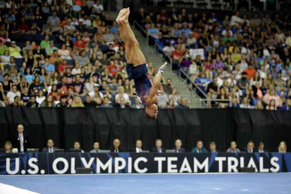 Sam Mikulak competes in the floor exercise during the U.S. men's Olympic gymnastics trials Saturday, June 25, 2016, in St. Louis. (AP Photo/Jeff Roberson)