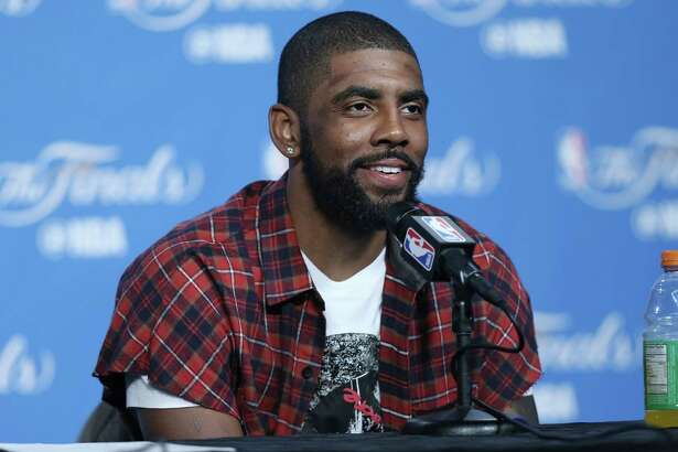 Cleveland Cavaliers' Kyrie Irving answers questions after Game 6 of the NBA basketball Finals against the Golden State Warriors, Friday, June 17, 2016, in Cleveland. The Cavaliers won 115-101. (AP Photo/Ron Schwane) ORG XMIT: OHTD105