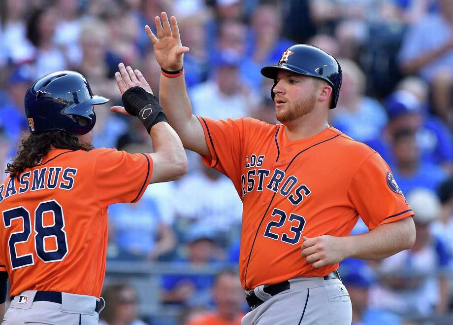 It didn't take long for Astros rookie A.J. Reed, right, to make an impact after his call-up, walking in the second inning and then scoring on a Luis Valbuena double. Photo: John Sleezer, MBR / Kansas City Star