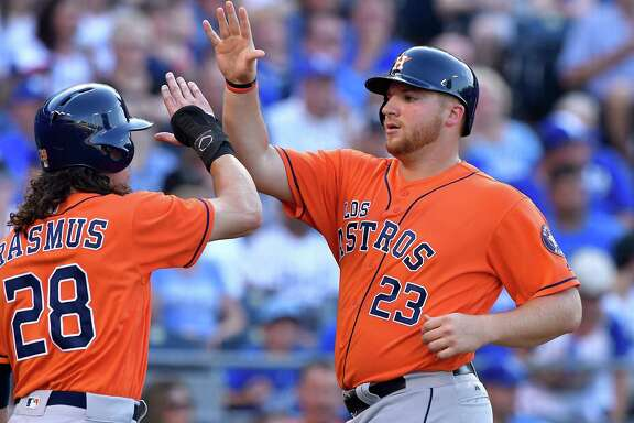 It didn't take long for Astros rookie A.J. Reed, right, to make an impact after his call-up, walking in the second inning and then scoring on a Luis Valbuena double.