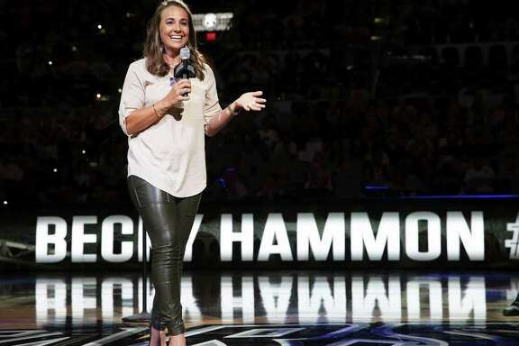 Becky Hammon thanks fans fans who watch her jersey retirement ceremony after the Stars host Atlanta at the AT&T Center on June 25, 2016.