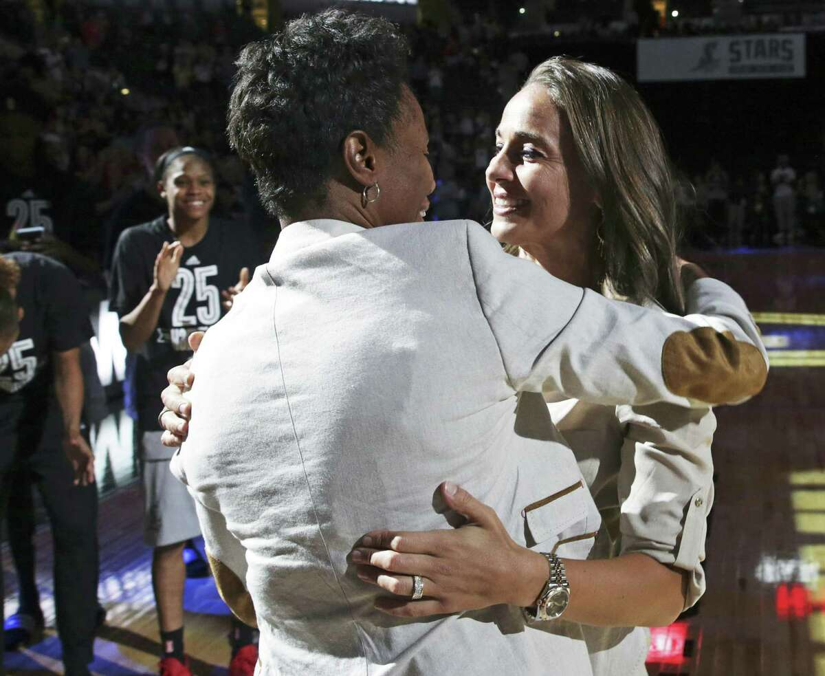 Becky Hammon gets a hug from Stars coach Vickie Johnson a former teammate on hand for Hammon's jersey retirement ceremony after the Stars hosted Atlanta at the AT&T Center on June 25, 2016.