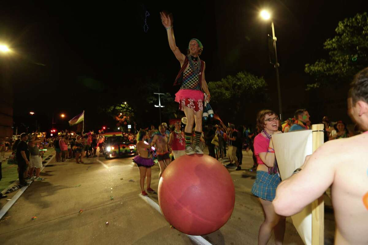 Mr. Cirque walks the parade route on top a ball Saturday, June 25, 2016, in Houston. The Houston Pride Festival and Pride Parade are at the center of the Celebration with an attendance of over 700,000 people every year from all over the world.