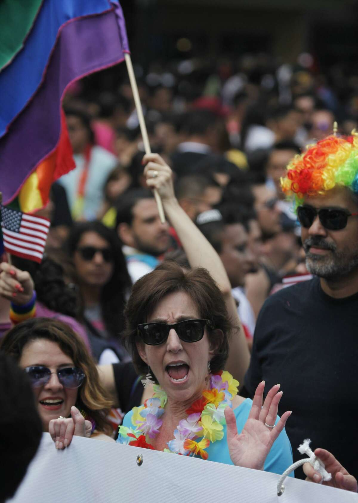 Roberta Jacobson, U.S. ambassador in Mexico, waves while marching in Mexico City's gay pride parade. Thousands of people marched down Paseo de la Reforma for one of the largest gay pride events in Latin America.