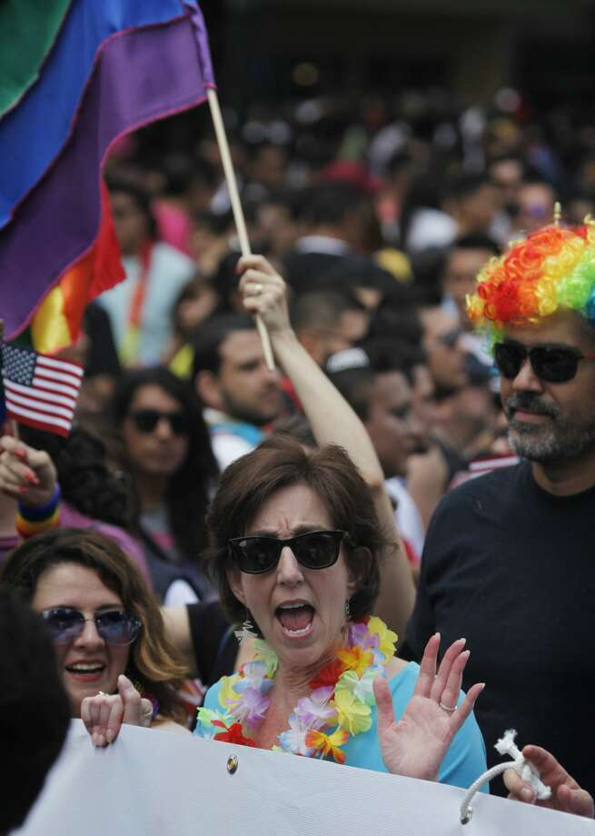 Roberta Jacobson, U.S. ambassador in Mexico, waves while marching in Mexico City's gay pride parade. Thousands of people marched down Paseo de la Reforma for one of the largest gay pride events in Latin America. Photo: Marco Ugarte/AP
