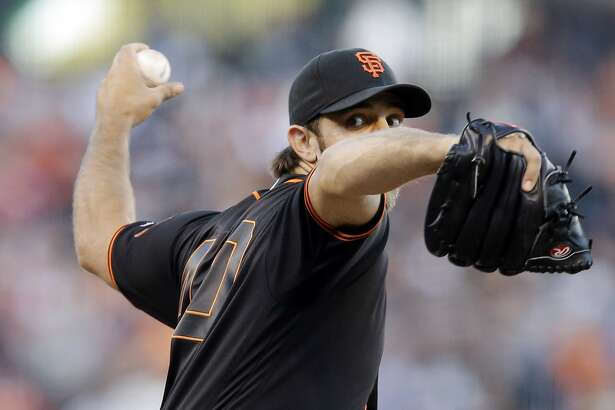 San Francisco Giants starting pitcher Madison Bumgarner throws to the Philadelphia Phillies during the second inning of a baseball game Saturday, June 25, 2016, in San Francisco. (AP Photo/Marcio Jose Sanchez)