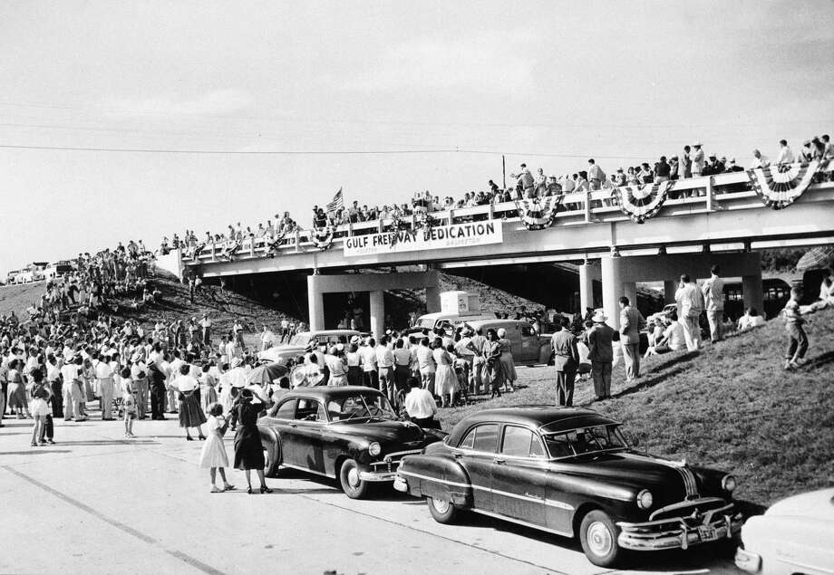A sizable crowd was on hand for the dedication ceremonies for a segment of the Gulf Freeway  on Aug. 2, 1952. The ceremonies took place on a hump north of Dickinson Bayou. Photo: Gunnar Lilequist Jr, HC Staff / Houston Chronicle