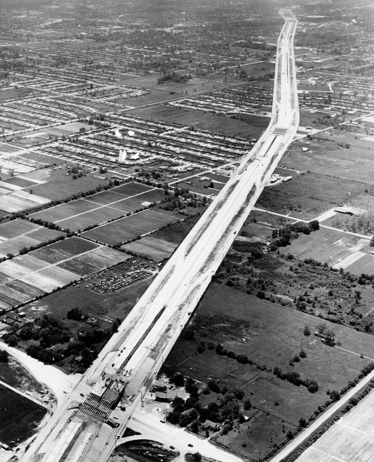 Then: Interstate 45 looking south toward Houston in May 1959. Little York Road appears at bottom.