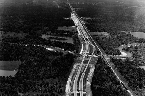 Interstate 45, looking north. Intersection of FM 1488 (west to Magnolia and Hempstead) north across the San Jacinto River to Conroe at top. May 10, 1959