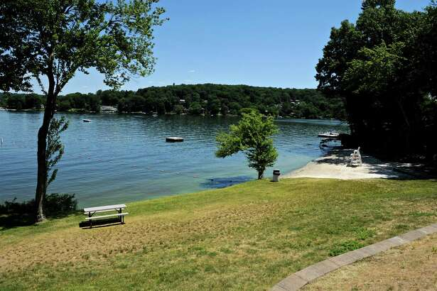 An empty New Fairfield Town Park which has been closed due to blue-green algae in the lake, which can emit toxins that can be harmful to people and dogs. Friday, June 24, 2016, in New Fairfield, Conn. First Selectman Susan Chapman said the park on Candlewood Lake was closed on Thursday and is expected to be re-opened Saturday or Sunday.