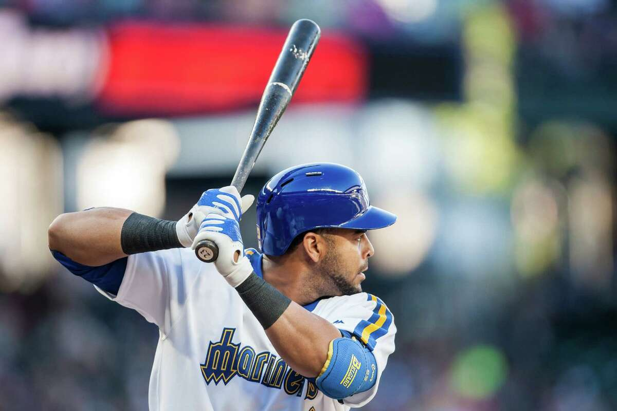 Nelson Cruz prepares for the pitch at Safeco Field during the Mariner's 5-4 victory over the St. Louis Cardinals on June 25, 2016. The theme for the night's game was Turn Back the Clock Night, featuring throwback jerseys from both teams and an 1980s costume contest.