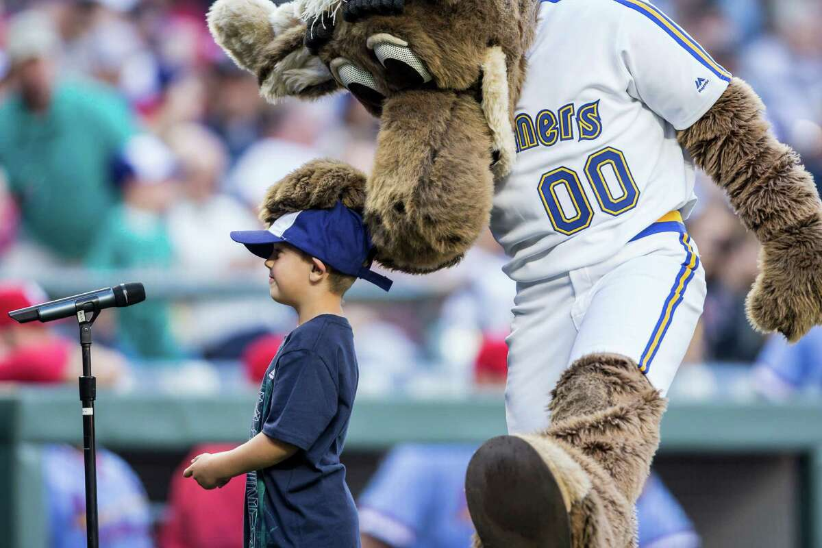 Mariner Moose congratulates a child after a successful shout of