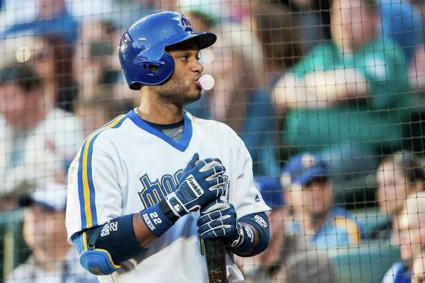 Robinson Cano blows a bubble before taking his at bat during the Mariner's 5-4 victory over St. Louis at Safeco Field on June 25, 2016.