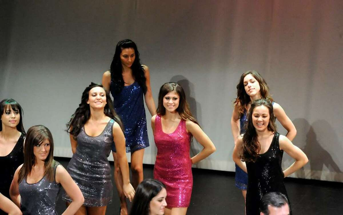 Stamford's Adriana Rizzuto, in pink at center, strikes a pose during the 20th Annual Miss Italia USA contest as winners of state competitions battle for the title of Miss Italia USA 2010 at the Palace Theater Sunday afternoon, April 25, 2010. Rizzuto is the daughter of ConAir executive Lee Rizzuto Jr. The Stamford-based manufacturer beauty products was a sponsor of the event. The winner will travel to Italy to compete against women from 49 countries for the title of Miss Italia nel Mondo.