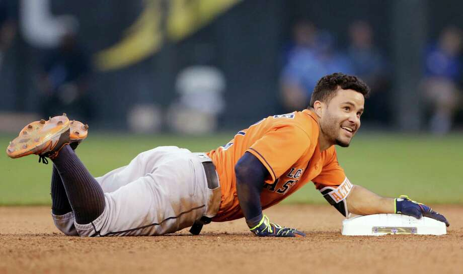 Houston Astros Jose Altuve reacts after tripping over second base while attempting a triple after a hit in the sixth inning of a baseball game against the Kansas City Royals at Kauffman Stadium in Kansas City, Mo., Saturday, June 25, 2016. The Astros beat the Royals 13-5. (AP Photo/Colin E. Braley) Photo: Colin E. Braley, Associated Press / FR123678 AP