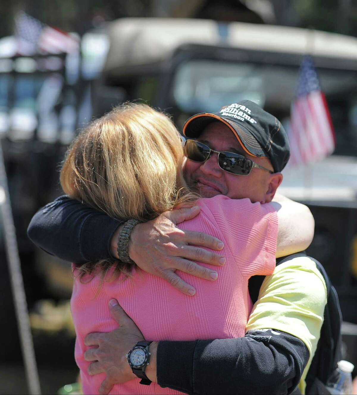 Newly retired, after 38 years of services, U.S. Army Staff Sergeant Steven Betancourt, who served in combat and was wounded in the Irag war, gets a hug from Lisa Ryan of Stamford during the Hooks for Heroes Charity Fishing Tournament at the Halloween Yacht Club in Stamford, Conn. on Saturday, June 25, 2016. The event brought together area Veterans and several injured Vets from the Walter Reed Army Hospital for a day of fishing on the Long Island Sound. Several thousands of dollars were raised to help benefit Operation Gift Cards, one of several charity's supporting combat wounded vets.