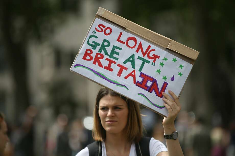 Demonstrators opposing Britain's exit from the European Union in Parliament Square following yesterday's EU referendum result hold a protest in London, Saturday, June 25, 2016. Britain voted to leave the European Union after a bitterly divisive referendum campaign. (AP Photo/Tim Ireland) Photo: Tim Ireland/AP