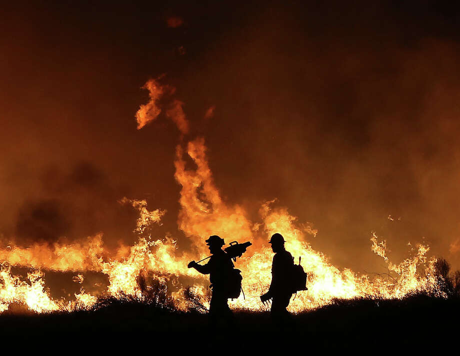Firefighters battle the Erskine Fire by lighting back fires Thursday night around 11pm in Lake Isabella, Calif., June 23, 2016. (Casey Christie/The Bakersfield Californian via AP) Photo: Casey Christie/AP