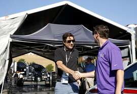 Actor Luke Wilson (center) shakes the hand of racer Denny Hamlin after being driven around the track before the Toyota/Save Mart 350 at Sonoma Raceway in Sonoma, California, on Sunday, June 26, 2016.