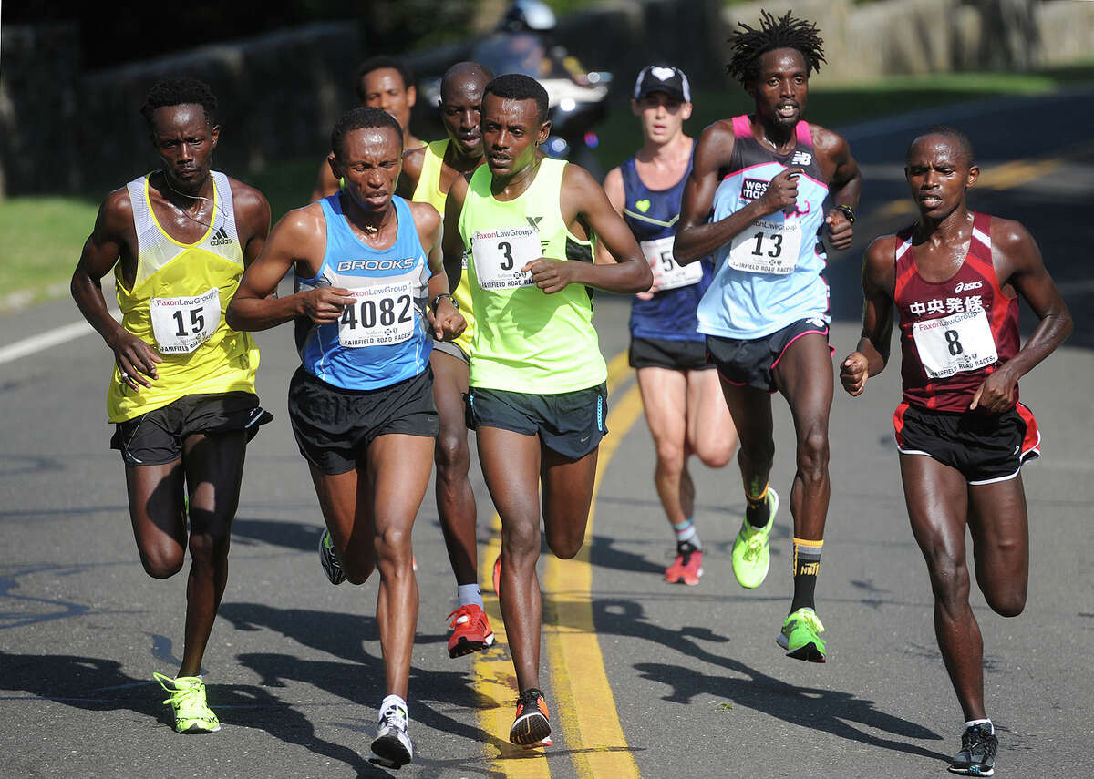 Elite runners compete in the lead pack during the 2016 Faxon Law Fairfield Half Marathon in Fairfield, Conn. on Sunday, June 26, 2016. Number 3, Tsegaye Getachw, center, of Ethiopia, was the eventual winner, breaking away with countryman number 4082, Ayele Megersa Feisa, in the second half of the race.