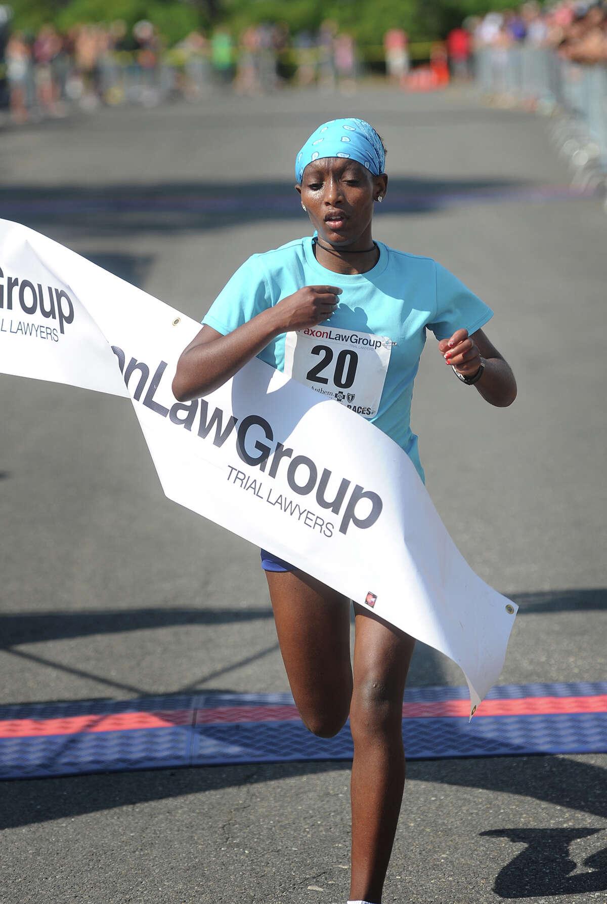 Ethiopian Sinke Biyadgilgn Dessie breaks the tape as the women's winner of the 2016 Faxon Law Fairfield Half Marathon in Fairfield, Conn. on Sunday, June 26, 2016.