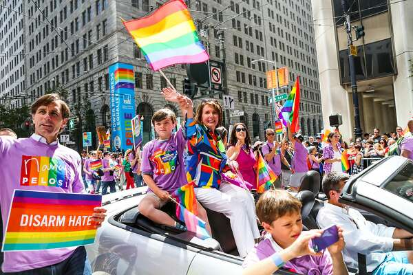Nancy Pelosi waves a flag from a car during the 46th annual LGBT Pride Parade, in San Francisco, California, on Sunday, June 26, 2016.