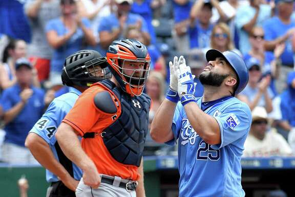 Kansas City Royals' Kendrys Morales celebrates his solo home run in front of Houston Astros designated hitter Evan Gattis during the fourth inning on Sunday, June 26, 2016, at Kauffman Stadium in Kansas City, Mo.