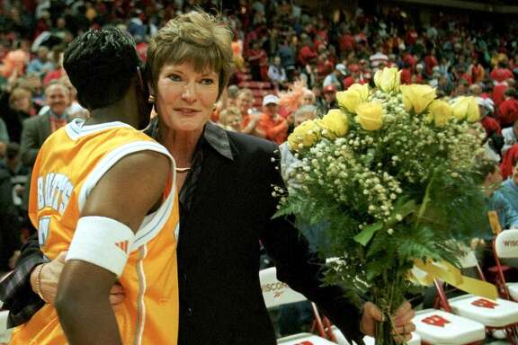 Tennessee's Niya Butts, left, gives coach Pat Summitt a hug and a bouquet of flowers after Summitt's 700th career victory Sunday, Dec. 5, 1999, in Madison, Wis. Tennessee beat Wisconsin 85-62. (AP Photo/Andy Manis)  HOUCHRON CAPTION (12/06/1999):   Niya Butts was one of the Tennessee players helping Pat Summitt commemorate her milestone Sunday.