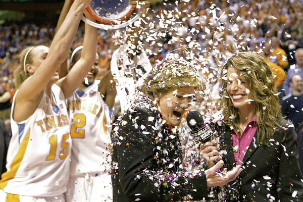 Tennessee coach Pat Summitt has confetti dumped on her by Alicia Manning (15) and Alex Fuller (2) after an NCAA college basketball game against Georgia on Thursday, Feb. 5, 2009 in Knoxville, Tenn. Tennessee won 73-43, giving Summitt her 1,000th career victory.