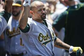 Oakland Athletics' Coco Crisp celebrates his grand slam home run against the Los Angeles Angels in the fourth inning of a baseball game Sunday, June 26, 2016, in Anaheim, Calif. (AP Photo/Lenny Ignelzi)