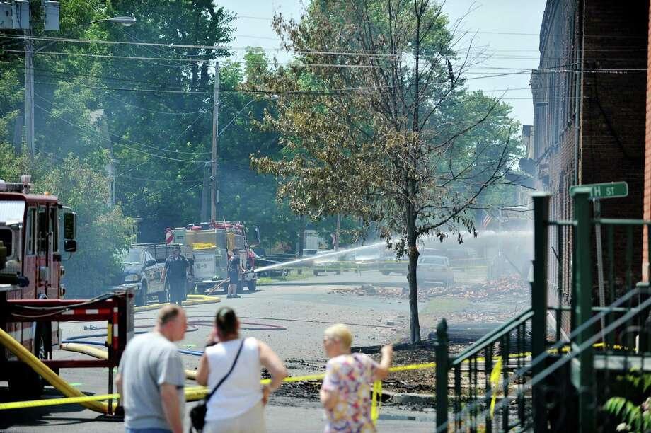 Firefighters work at the scene of a warehouse fire on Broadway on Sunday, June 26, 2016, in Watervliet, N.Y.  (Paul Buckowski / Times Union)