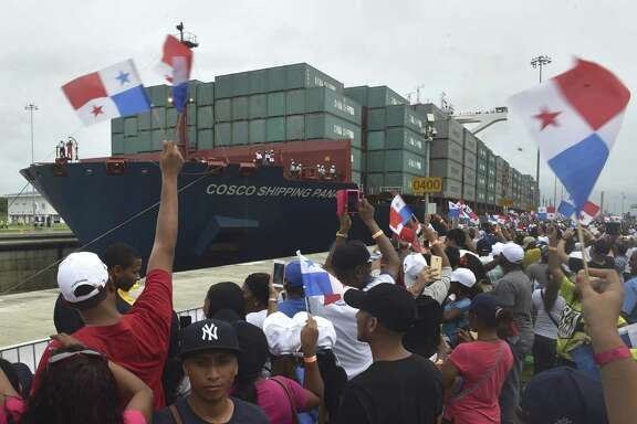 Thousands cheer Sunday as a Chinese merchant ship become the first to cross the new Cocoli locks at the Panama Canal.