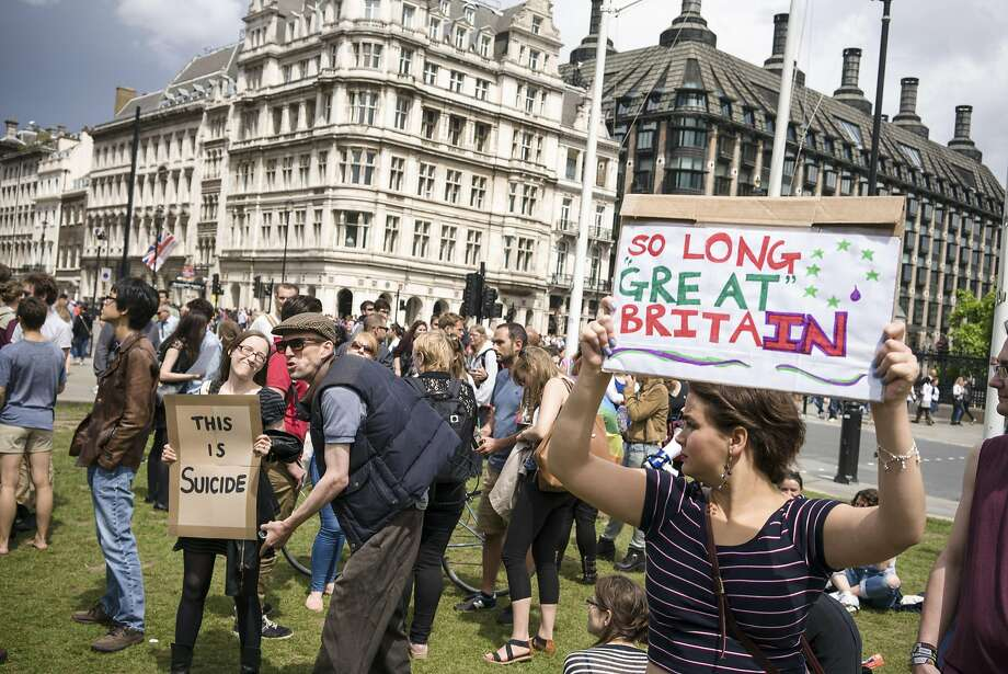 A supporter of the Brexit taunts pro European Union demonstrators at Westminster in London, June 25, 2016. There is unease about what the future will hold for London as a financial capital, amid repeated warnings that tens of thousands of jobs will move to continental Europe. (Marco Kesseler/The New York Times) Photo: MARCO KESSELER, NYT
