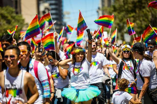 Kimberly Pickup (center) walks on Market Street as she participates in the 46th annual LGBT Pride Parade, in San Francisco, California, on Sunday, June 26, 2016.