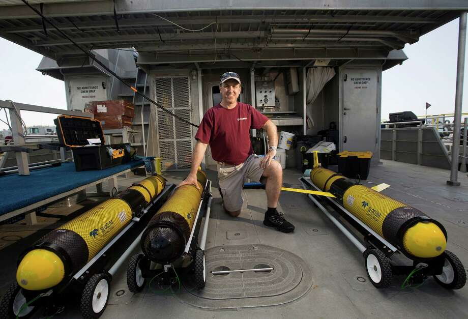 "Portrait of Steve DiMarco a Texas A&M oceanography professor and ocean observing team leader, on the boat the RV Manta, next to a group of Slocum gliders that will provide oxygen readings in the ""dead zone"" along the Texas and Louisiana coast Tuesday, June 17, 2014, on Pelican Island in Galveston. The gliders will be dropped off at three different points and left until September where he and his team will be able to obtain oxygen and physiological readings of the water while in College Station and then provides that data to organizations such as the National Oceanic and Atmospheric Administration (NOAA).  ( Johnny Hanson / Houston Chronicle ) Photo: Johnny Hanson, Staff / Houston Chronicle / © 2014  Houston Chronicle"
