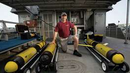 "Portrait of Steve DiMarco a Texas A&M oceanography professor and ocean observing team leader, on the boat the RV Manta, next to a group of Slocum gliders that will provide oxygen readings in the ""dead zone"" along the Texas and Louisiana coast Tuesday, June 17, 2014, on Pelican Island in Galveston. The gliders will be dropped off at three different points and left until September where he and his team will be able to obtain oxygen and physiological readings of the water while in College Station and then provides that data to organizations such as the National Oceanic and Atmospheric Administration (NOAA).  ( Johnny Hanson / Houston Chronicle )"