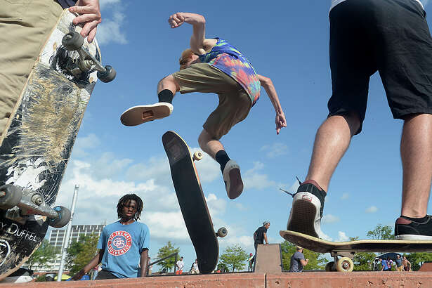 Skaters practice their stunts on the ramps at Saturday's Skate Jam, held at the City of Beaumont's skate park. Several local bands took to a nearby stage to perform their original tunes for the crowd of music enthusiasts. In addition to vendors providing cool treats, the city offered free water and hot dogs to concert-goers. Photo taken Saturday, June 25, 2016 Kim Brent/The Enterprise