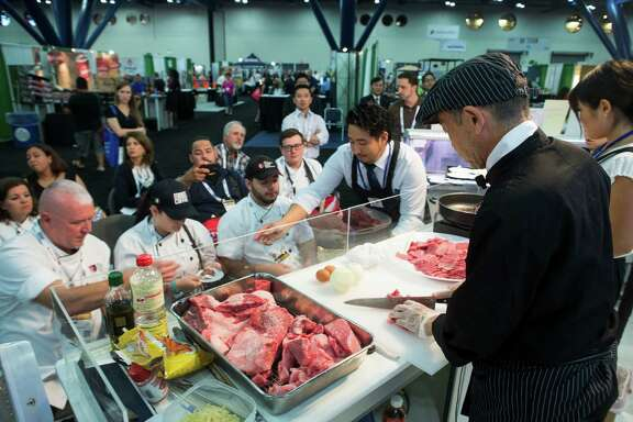 Kazuo Eguchi cooks Wagyu beef samples at the Japan Livestock Export Promoional Council booth during the 79th annual Texas Restaurant Association Marketplace at the George R. Brown Convention Center on Sunday, June 26, 2016, in Houston.