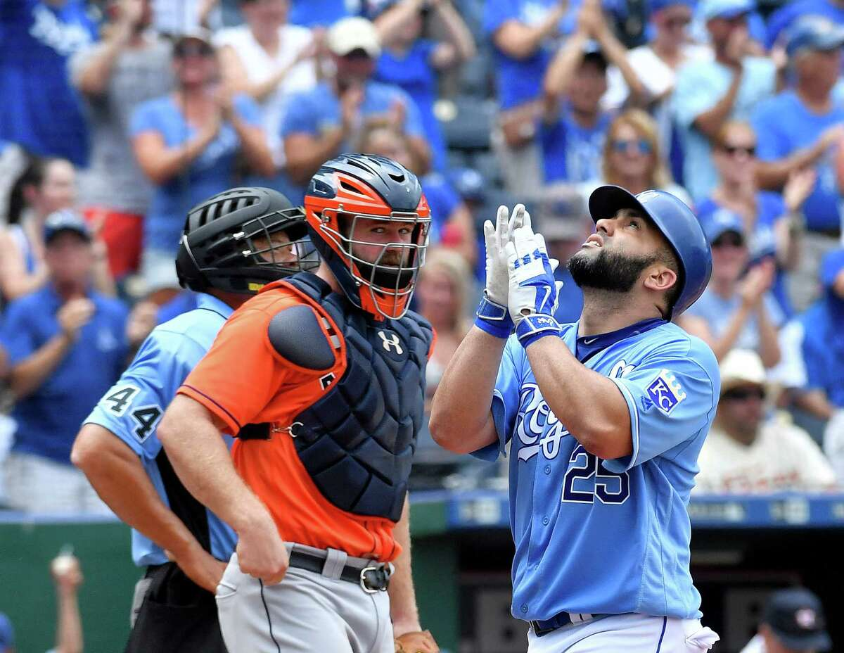 To Evan Gattis' dismay, K.C.'s Kendrys Morales (25) celebrates the first of his two solo home runs Sunday.