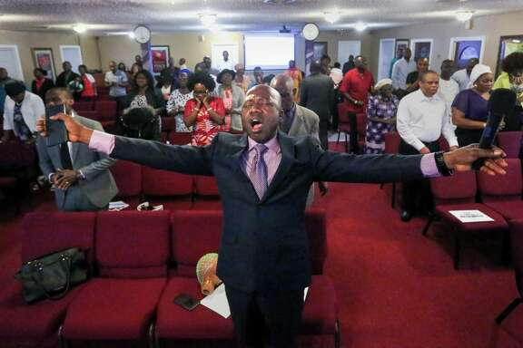 Pastor John Okperuvwe started a branch of the  Redeemed Christian Church of God in his living room; the congregation now fills a 250-seat hall most Sundays in Huntsville.