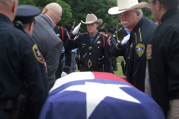 Police officers salute as pallbearers move the casket of Patton Village police Sgt. Stacey Baumgartner into a hearse after funeral at the Woodlands Church, One Fellowship Drive, Friday, June 24, 2016, in The Woodlands.