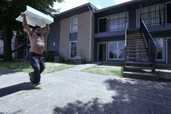 Contractor Steven Nava carries a sink into a Arbor Court apartment, federally subsidized housing that's located in a floodplain Friday, June 24, 2016, in Houston. Many residents who were displaced during Houston's April 18 flooding.