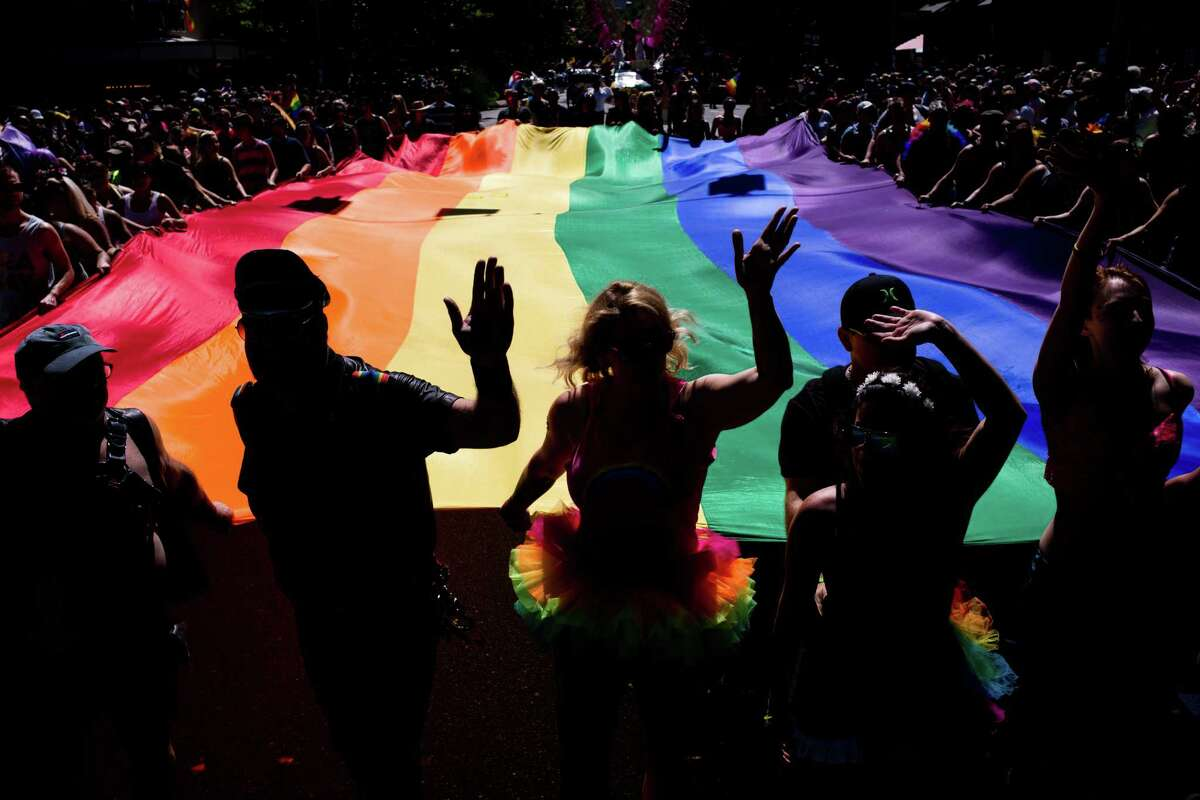 One of several enormous pride flags is carried by dozens in the 42nd annual Seattle Pride Parade on Sunday, June 26, 2016.