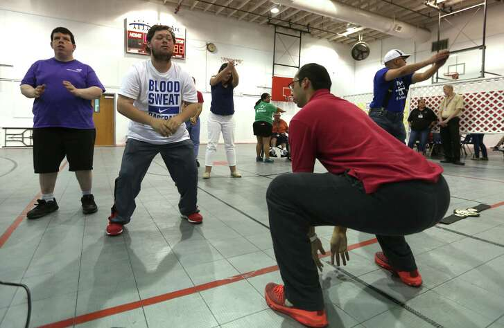 Life enrichment instructor Adrian Gonzales (right) leads participants in some exercises in a recent class The Arc of San Antonio is one of three chapters nationwide to be selected to participate in the Health and Fitness for All project.
