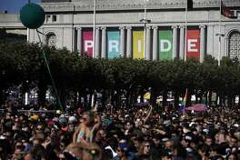 Pride banners hang from the Asian Art Museum at Civic Center Plaza as thousands gathered to celebrate San Francisco Pride in San Francisco, Calif., on Sunday, June 26, 2016.