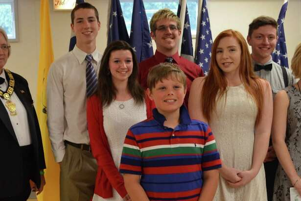 Rensselaer Elks Lodge #2073 conducted its 58th annual Flag Day Ceremony on Saturday June 12 with about 75 people in attendance, including six veterans. From left, Exalted Ruler Linda Rowse; Joseph Somerville and Kristen Singleman of Columbia High School; Jackson Collins - Americanism; Gabriel Stephan and Cassandra Costa of Rensselaer High School; Noah Boland and Samara Holmes of Averill Park High School are shown. The program included a chronological history of the American flags presented by Boy Scout Troop #41 (which the lodge sponsors).  Guest speakers included Lt. Col./Incoming Chief of Staff Michael Murphy, 42nd Infantry Division, and state Sen. Kathleen Marchione. The Elks also recognized one Americanism essay contest winner, Jackson Collins, and eight local high school seniors who were each awarded $500 scholarships. The other eight student winners were Joseph Somerville and Kristen Singleman of Columbia High School; Gabriel Stephan and Cassandra Costa of Rensselaer High; Noah Boland and Samara Holmes of Averill Park High; Ryan Lansing and Alexandra Stuto of Maple Hill High School. Patriotic music was performed by Laura Haney of Columbia High School.